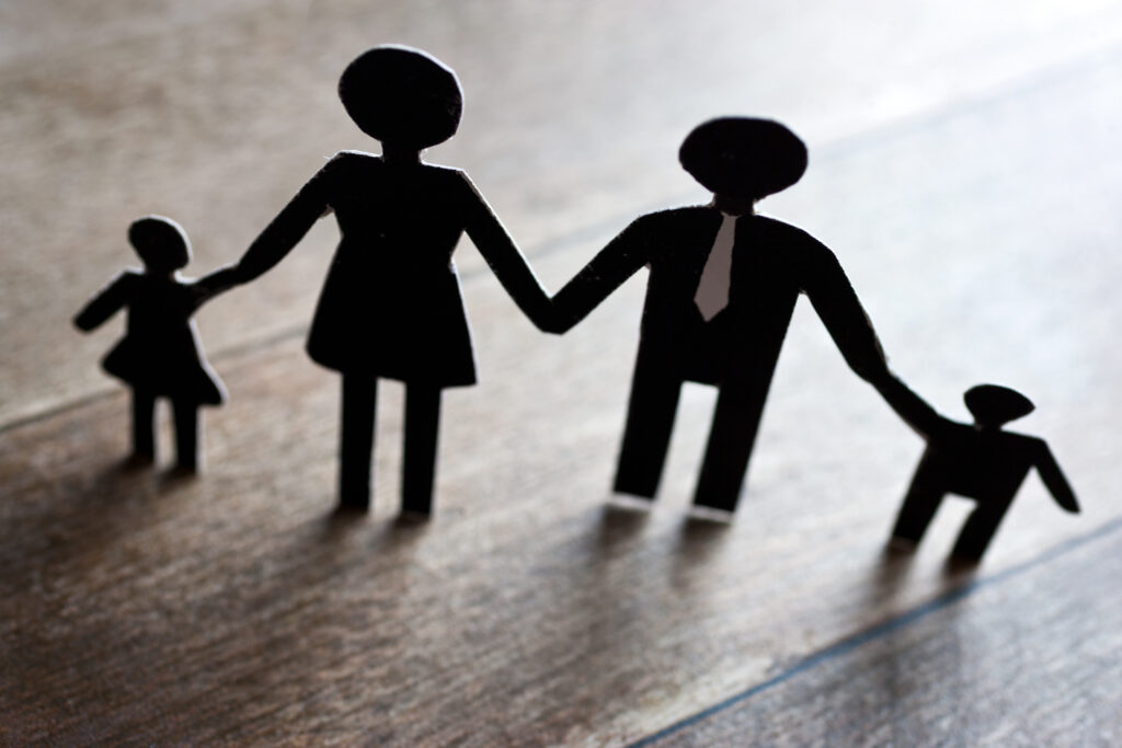 Silhouette showing a family holding hands