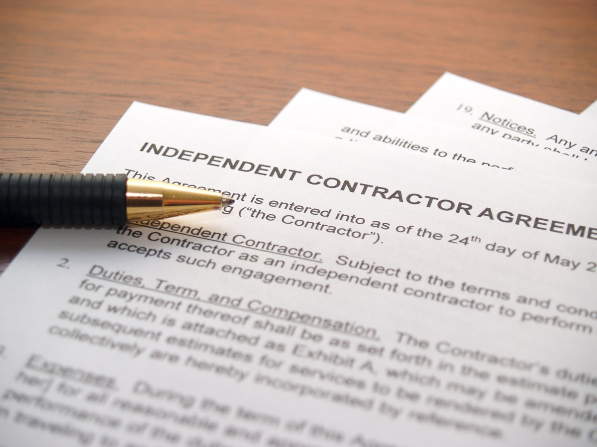 Independent contractor agreement with pen resting on top