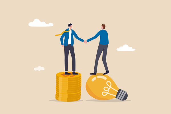 Illustration of two businesspeople standing on coins shaking hands after making a VC financing deal