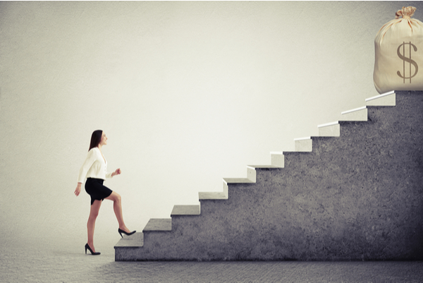 Graphic showing the stepping stones to setting starting salaries that are fair using a business woman walking up a concrete staircase towards a bag of money showing ideal salary.