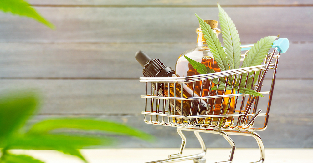 CBD products in a tiny shopping cart showing CBD marketing compliance